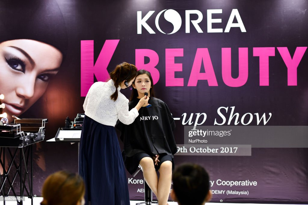 Malaysian model gets her makeup from a South Korean exhibitor during the Beauty Expo 2017 on October 6, 2017 at Kuala Lumpur Convention Centre, Malaysia. Beauty Expo 2017 is the highly anticipated annual event in Malaysia for all beauty professionals of the industry. Participants with over 200 international and local exhibiting companies from 25 partcipating countries including South Korea, Japan, China and Thailand.
