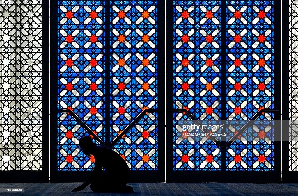 A Malaysian Muslim man offers prayers during the holy Islamic month of Ramadan at the Sultan Salahuddin Abdul Aziz Shah Mosque in Shah Alam on June 24, 2015. More than 1.5 billion Muslims around the world are marking the month, during which believers abstain from eating, drinking, smoking and having sex from dawn until sunset.