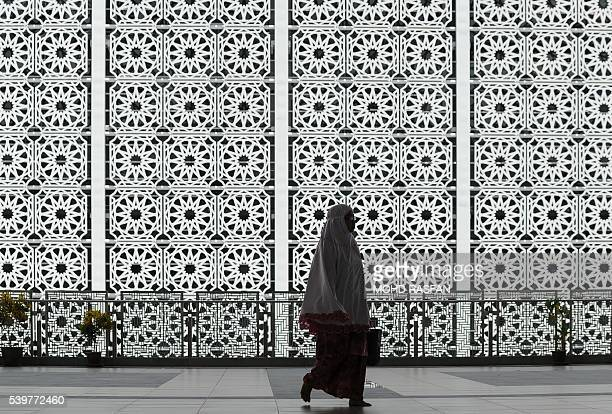 Malaysian Muslim woman attends an afternoon prayers at the Tuanku Mizan Zainal Abidin mosque in Putrajaya on June 13 2016 Islam's holy month of...