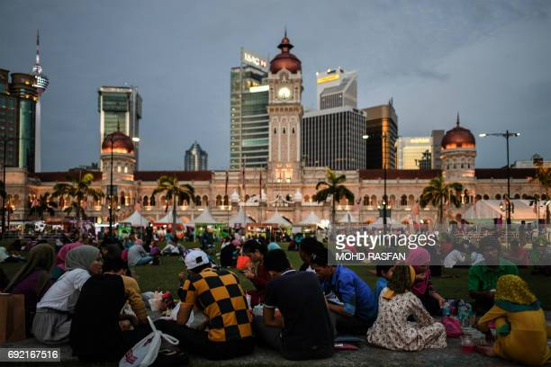 Malaysian Muslims break their fast during the holy Islamic month of Ramadan at Merdeka Square in Kuala Lumpur on June 4 2017 Islam's holy month of...