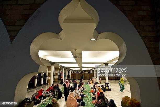 Malaysian Muslims break their fast on the first day of the holy Islamic month of Ramadan in Kuala Lumpur on June 18 2015 Tens of millions across the...