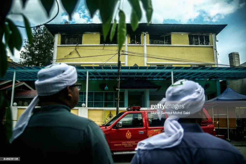Malaysian Muslims look at the view of religious school Darul Quran Ittifaqiyah after a fire broke out on September 14, 2017 in Kuala Lumpur, Malaysia. A fire at a religious school Darul Quran Ittifaqiyah had killed at least 24 people including their religious teacher.