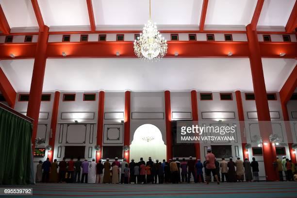 Malaysian Muslims offer evening prayers during the holy month of Ramadan at the MelakaChinese mosque in Krubong Malacca on June 13 2017 The unique...