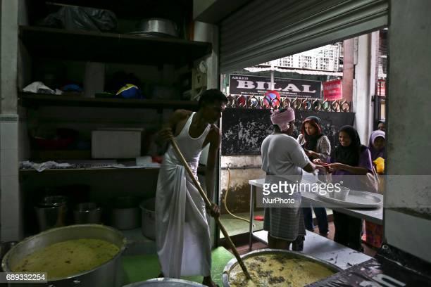 Malaysian Muslims prepares ''bubur lambuk'' for the ummah to break fast at the mosque in Jalan Masjid India Kuala Lumpur Malaysia on 28 May 2017