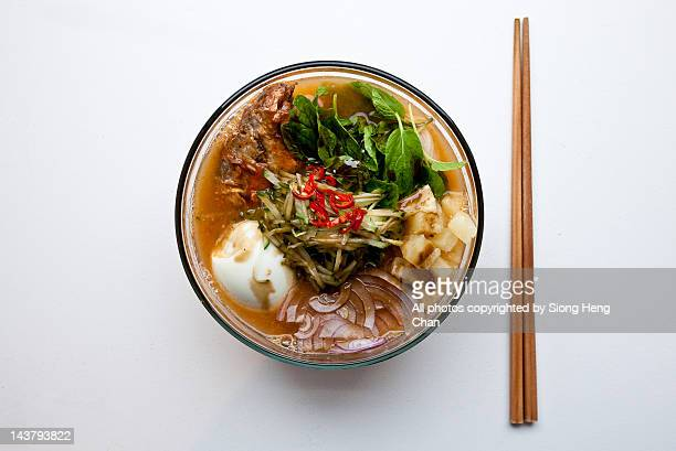 Malaysian noodles laksa in bowl and chopsticks