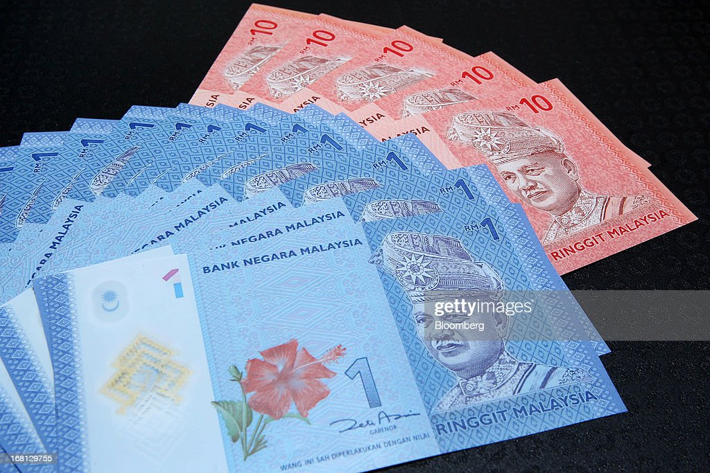 Malaysian one ringgit and ten ringgit banknotes are arranged for a photograph in Kuala Lumpur, Malaysia, on Friday, May 3, 2013. Malaysia's stocks jumped the most since 2008 after Prime Minister Najib Razak won a clear majority in the election, giving him a mandate to continue his economic reforms. The ringgit gained the most in three years. Photographer: Goh Seng Chong/Bloomberg via Getty Images