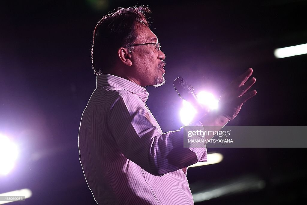 Malaysian opposition leader Anwar Ibrahim gestures while addressing his supporters at a gathering in Kuala Lumpur on February 9, 2015. Malaysia's highest court is expected to deliver a final decision on February 10, on Anwar's appeal against a sodomy conviction and five-year jail term handed down last year.