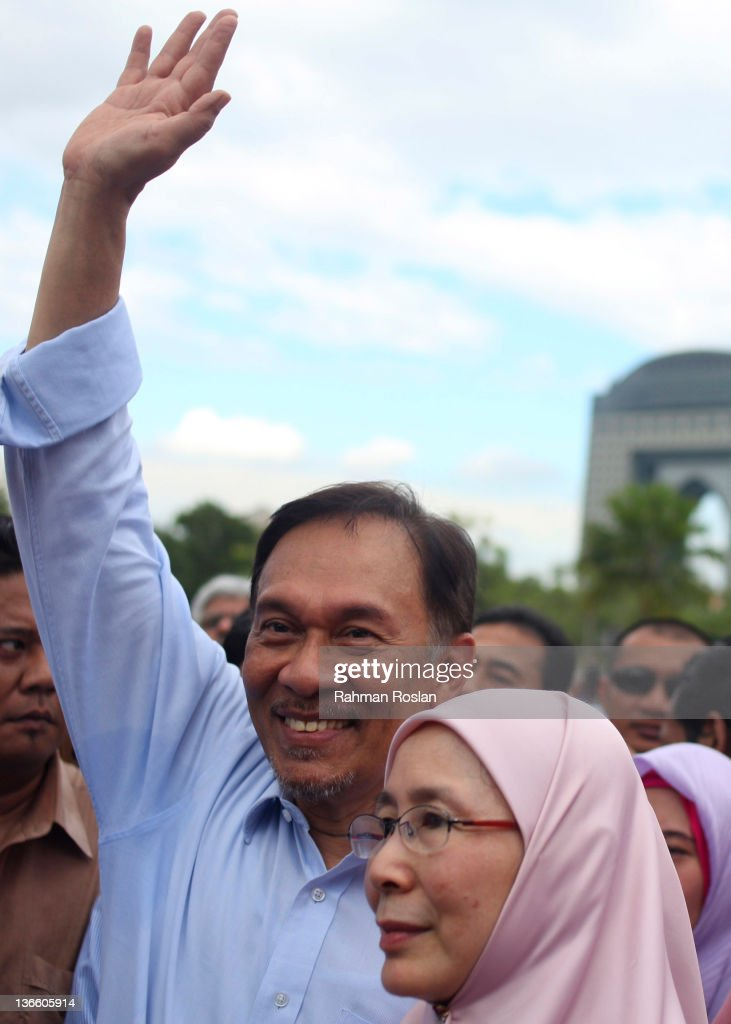 Malaysian opposition leader <a gi-track='captionPersonalityLinkClicked' href=/galleries/search?phrase=Anwar+Ibrahim&family=editorial&specificpeople=600601 ng-click='$event.stopPropagation()'>Anwar Ibrahim</a> greets supporters after he was acquited from his sodomy charge outside the High Court on January 9, 2012 in Kuala Lumpur, Malaysia. Ibrahim, 64, was aquitted today on charges he sodomized a former aide, then aged 23, in 2008 . Judge Zabidin Mohama Diah, said the court was unable to prove that DNA evidence submitted was not comprimised and dismissed the charges. Sodomy is illegal in the majority muslim country and violaters face a 20 year prison sentence.