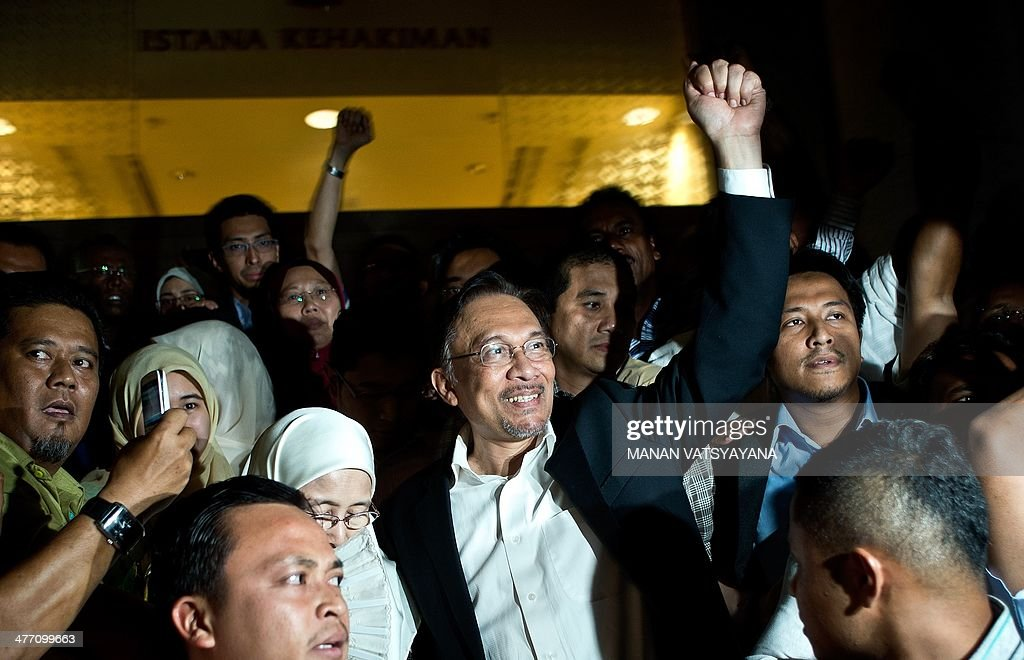 Malaysian opposition leader <a gi-track='captionPersonalityLinkClicked' href=/galleries/search?phrase=Anwar+Ibrahim&family=editorial&specificpeople=600601 ng-click='$event.stopPropagation()'>Anwar Ibrahim</a> (C) waves to supporters as he leaves the court of appeals in Putrajaya, outside Kuala Lumpur on March 7, 2014. Malaysian opposition leader <a gi-track='captionPersonalityLinkClicked' href=/galleries/search?phrase=Anwar+Ibrahim&family=editorial&specificpeople=600601 ng-click='$event.stopPropagation()'>Anwar Ibrahim</a> had his acquittal for sodomy overturned March 7, in a fresh threat to the remarkable career of a charismatic politician who helped turn around the country's once-hapless opposition. AFP PHOTO/ MANAN VATSYAYANA