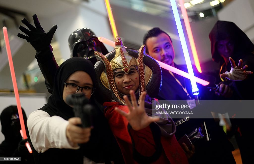 Malaysian participants dressed as popular 'Star Wars' characters pose during an event to mark the Star Wars Day celebration in Kuala Lumpur on April 30, 2016. / AFP / MANAN