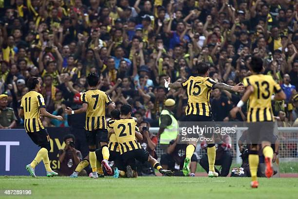 Malaysian players celebrate after scoring against Saudi Arabia during the 2018 Russia FIFA World Cup and 2019 UAE Asian Cup Preliminary Round 2 joint...
