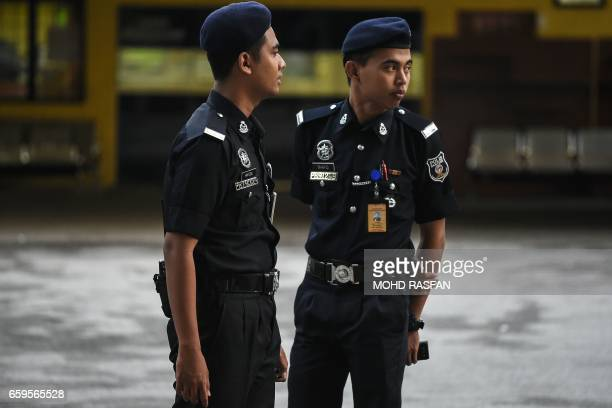 Malaysian police man the forensics wing main gate of the Hospital Kuala Lumpur where the body of Kim JongNam halfbrother of North Korea's leader Kim...