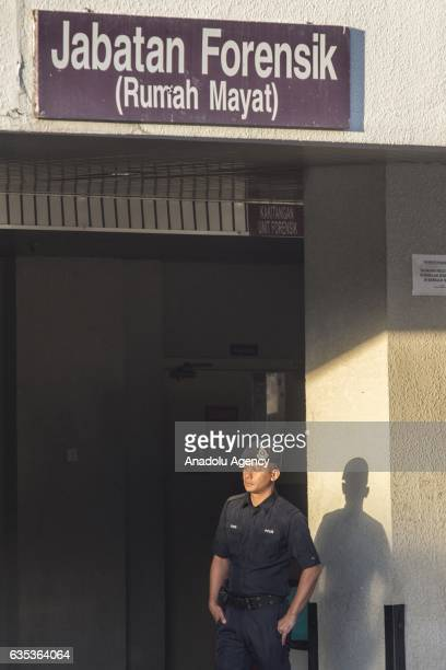 Malaysian police officer guards the entrance to the Forensic Department of the Putrajaya Hospital outside Kuala Lumpur on February15 2017 45yearold...