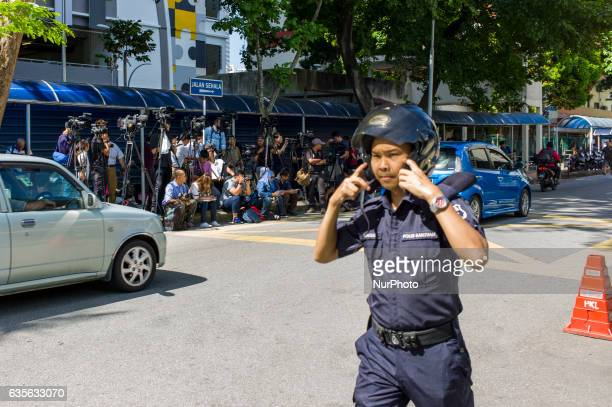 A Malaysian police officer guards the entrance to the Institute of Forensic Medicine of Kuala Lumpur Hospital on February 16 2017 45yearold Kim...