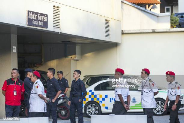 Malaysian police officers guard the entrance to the Forensic Department of the Putrajaya Hospital outside Kuala Lumpur Malaysia on February15 2017...