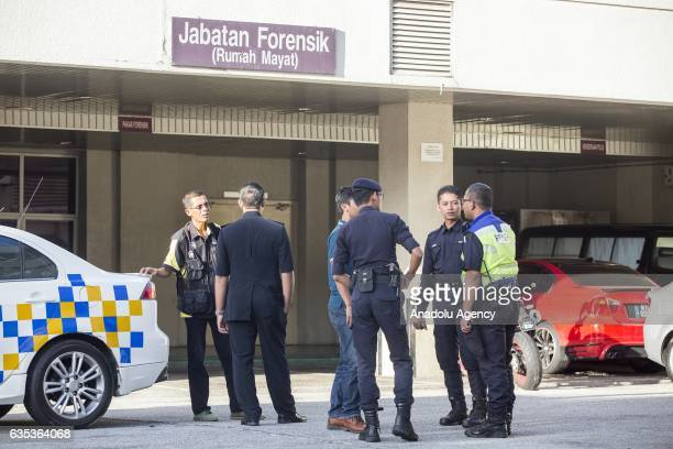 Malaysian police officers guard the entrance to the Forensic Department of the Putrajaya Hospital outside Kuala Lumpur on February15 2017 45yearold...