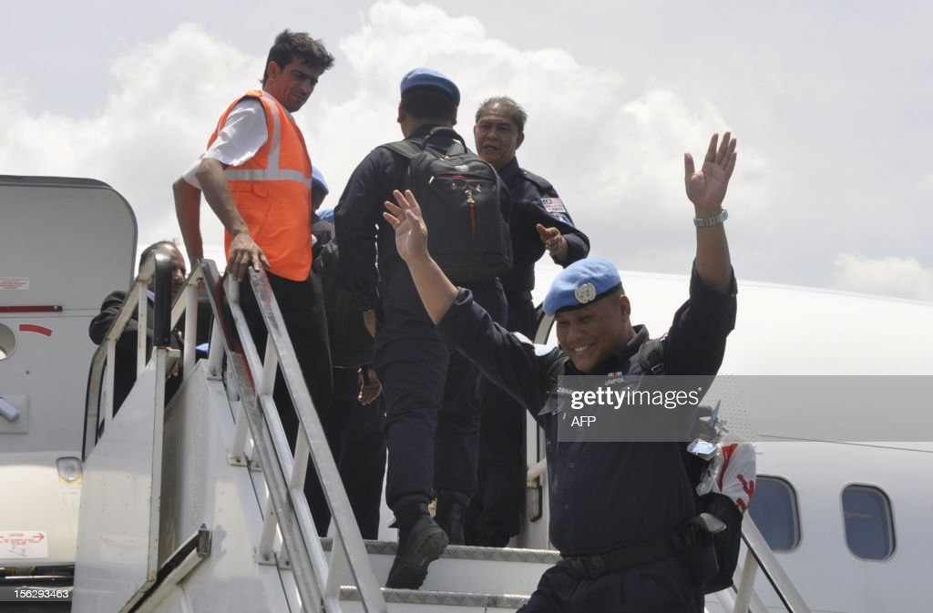 A Malaysian police officers incorporated in UN Peacekeeper gestures as they leave for Kuala Lumpur, in Dili on November 13, 2012. UN peacekeepers in East Timor on October 31 handed full responsibility for policing to Asia's youngest nation, Prime Minister Xanana Gusmao announced. East Timor, an impoverished half-island nation of 1.1 million despite bountiful oil and gas reserves off its coasts, in May celebrated a decade of formal independence after a 24-year occupation by Indonesia.