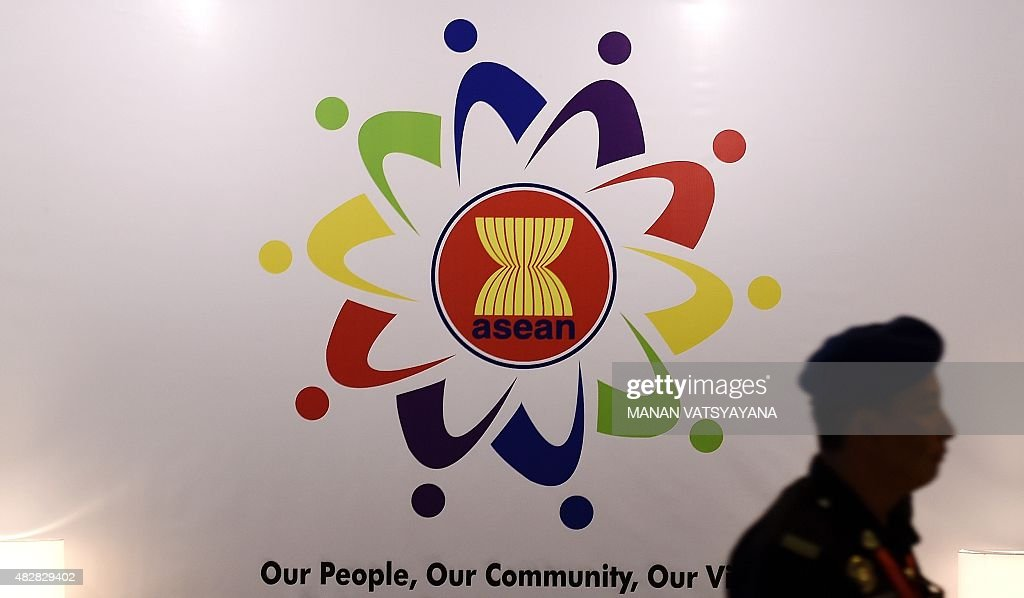 A Malaysian police official walks past the Association of Southeast Asian Nations logo at the Putra World Trade Centre in Kuala Lumpur on August 3...