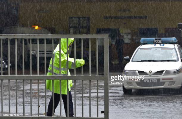 A Malaysian Police personnel mans the main gate of the Forensic wing at the Hospital Kuala Lumpur in Kuala Lumpur on 8 March 2017 where the body of a...