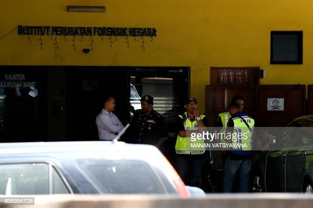 Malaysian police personnell stand guard outside the Forensic wing at the Hospital Kuala Lumpur in Kuala Lumpur on February 15 2017 where the body of...