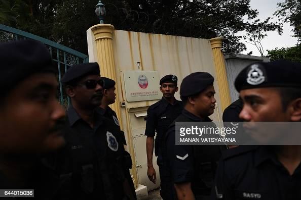 Malaysian police stand guard during a protest by United Malays National Organization Youth activists outside the North Korean Embassy in Kuala Lumpur...