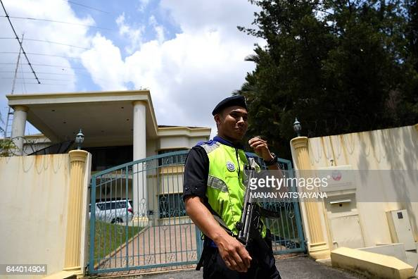 A Malaysian policeman cordons off the area outside the North Korean Embassy in Kuala Lumpur on February 23 2017 ahead of a protest by the United...