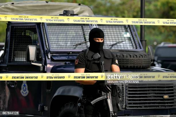 A Malaysian policeman keeps watch during the court appearance of Indonesian national Siti Aisyah and Vietnamese national Doan Thi Huong at the...