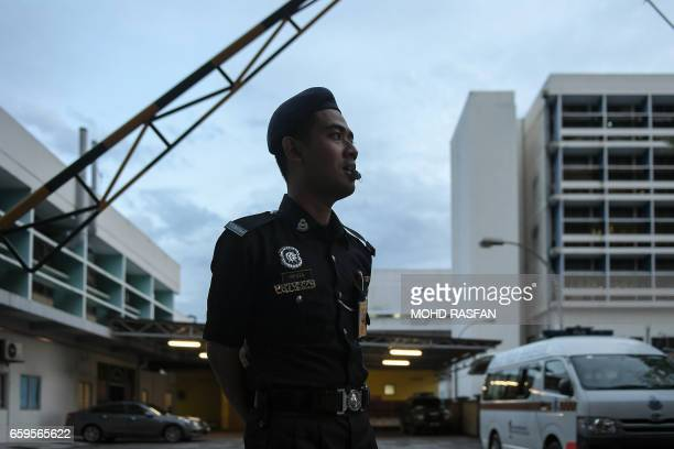 A Malaysian policeman mans the forensics wing main gate of the Hospital Kuala Lumpur where the body of Kim JongNam halfbrother of North Korea's...