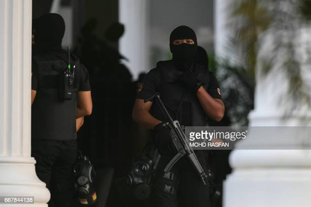 Malaysian policemen keep watch during the court appearance of Indonesian national Siti Aisyah and Vietnamese national Doan Thi Huong at the...