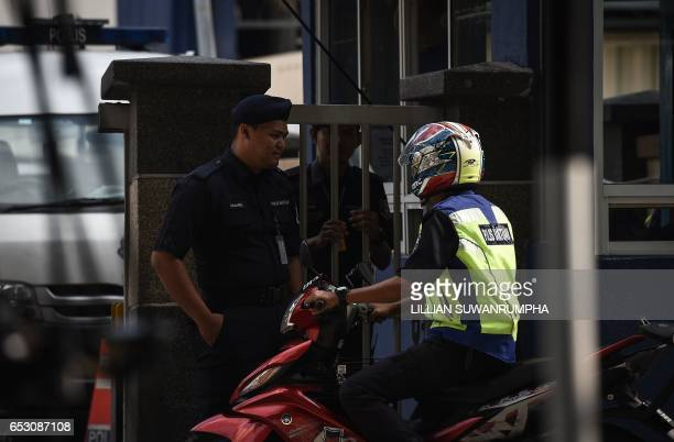 Malaysian policemen talk to each other at the gate of the forensics wing of the Hospital Kuala Lumpur where the body of Kim JongNam is being held in...