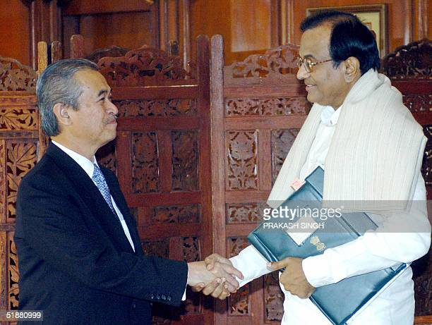 Malaysian Prime Minister Abdullah Ahmad Badawi shakes hands with Indian Finance Minister P Chidambaram prior to a meeting in New Delhi 20 December...