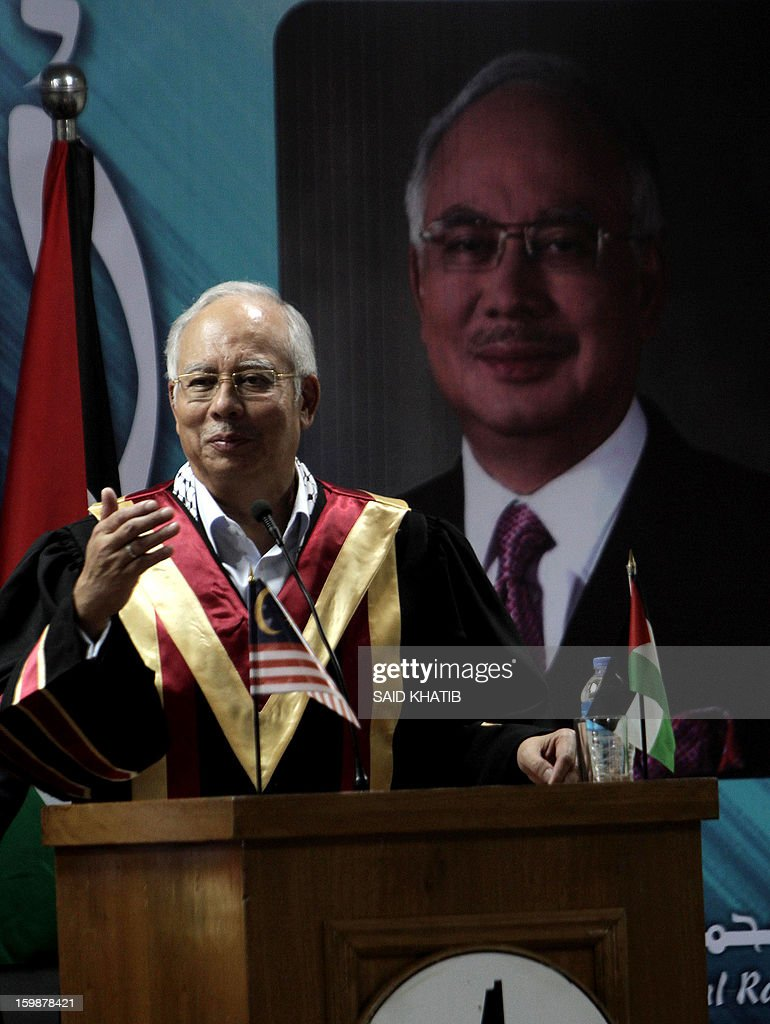 Malaysian Prime Minister Najib Razak addresses a ceremony during a visit to the Al-Aqsa University in Khan Yunis in the southern Gaza Strip January 22, 2013. Razak pledged solidarity with the Palestinians on his first trip to Gaza, and backed reconciliation efforts between Hamas and Fatah.