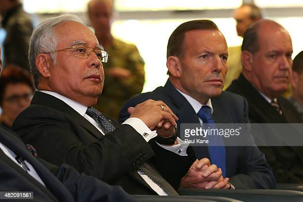 Malaysian Prime Minister Najib Razak and Australian Prime Minister Tony Abbott look on as Air Chief Marshall Angus Houston commences his briefing...