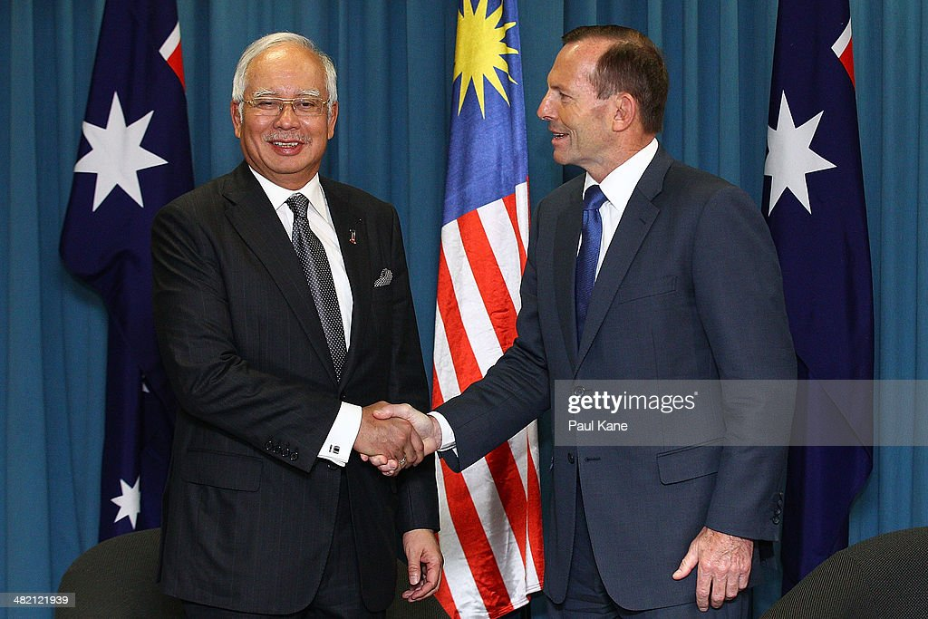 Malaysian Prime Minister Najib Razak and Australian Prime Minister <a gi-track='captionPersonalityLinkClicked' href=/galleries/search?phrase=Tony+Abbott&family=editorial&specificpeople=220956 ng-click='$event.stopPropagation()'>Tony Abbott</a> shake hands before a bilateral meeting held at the Commonwealth Parliament Offices at Exchange Plaza on April 3, 2014 in Perth, Australia. The search continues off the Western Australian coast for Malaysia Airlines flight MH370 that vanished on March 8 with 239 passengers and crew on board. The flight is suspected to have crashed into the southern Indian Ocean with no survivors.