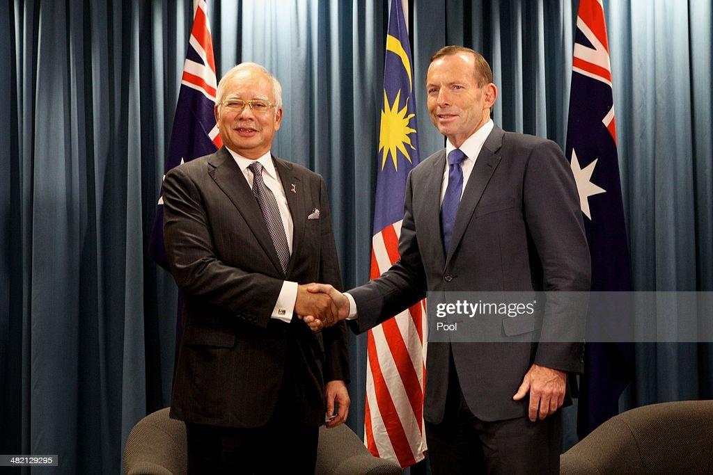 Malaysian Prime Minister Najib Razak and Australian Prime Minister <a gi-track='captionPersonalityLinkClicked' href=/galleries/search?phrase=Tony+Abbott&family=editorial&specificpeople=220956 ng-click='$event.stopPropagation()'>Tony Abbott</a> shake hands during a bilateral meeting at the Commonwealth Parliament Offices at Exchange Plaza on April 3, 2014 in Perth, Australia. The search continues off the Western Australian coast for Malaysia Airlines flight MH370 that vanished on March 8 with 239 passengers and crew on board. The flight is suspected to have crashed into the southern Indian Ocean with no survivors.