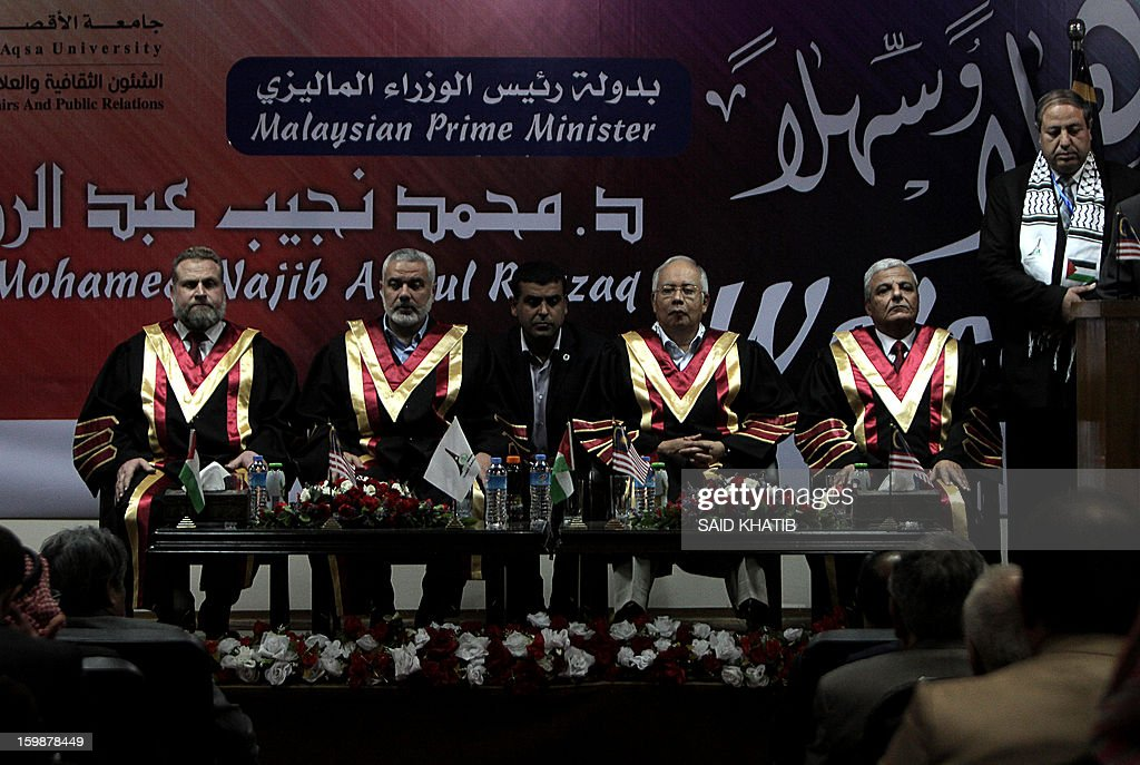 Malaysian Prime Minister Najib Razak (C-R) and Palestinian Hamas prime minister Ismail Haniya (C-L) attend a ceremony at the Al-Aqsa University in Khan Yunis in the southern Gaza Strip January 22, 2013. Razak pledged solidarity with the Palestinians on his first trip to Gaza, and backed reconciliation efforts between Hamas and Fatah.