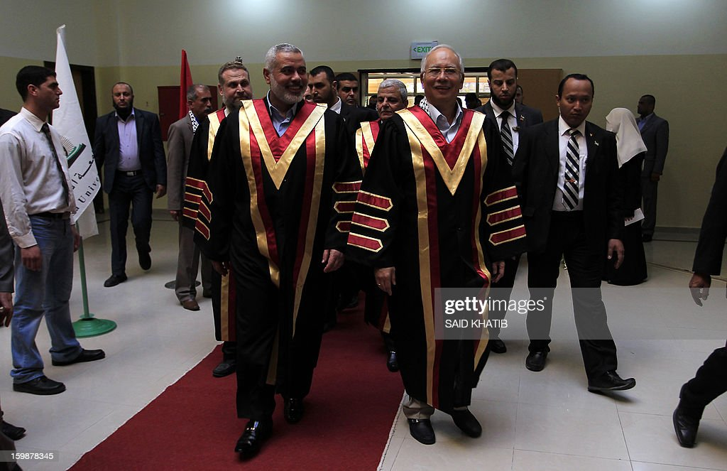 Malaysian Prime Minister Najib Razak (C-R) arrives with Palestinian Hamas prime minister Ismail Haniya (C-L) for a visit to the Al-Aqsa University in Khan Yunis in the southern Gaza Strip January 22, 2013. Razak pledged solidarity with the Palestinians on his first trip to Gaza, and backed reconciliation efforts between Hamas and Fatah.