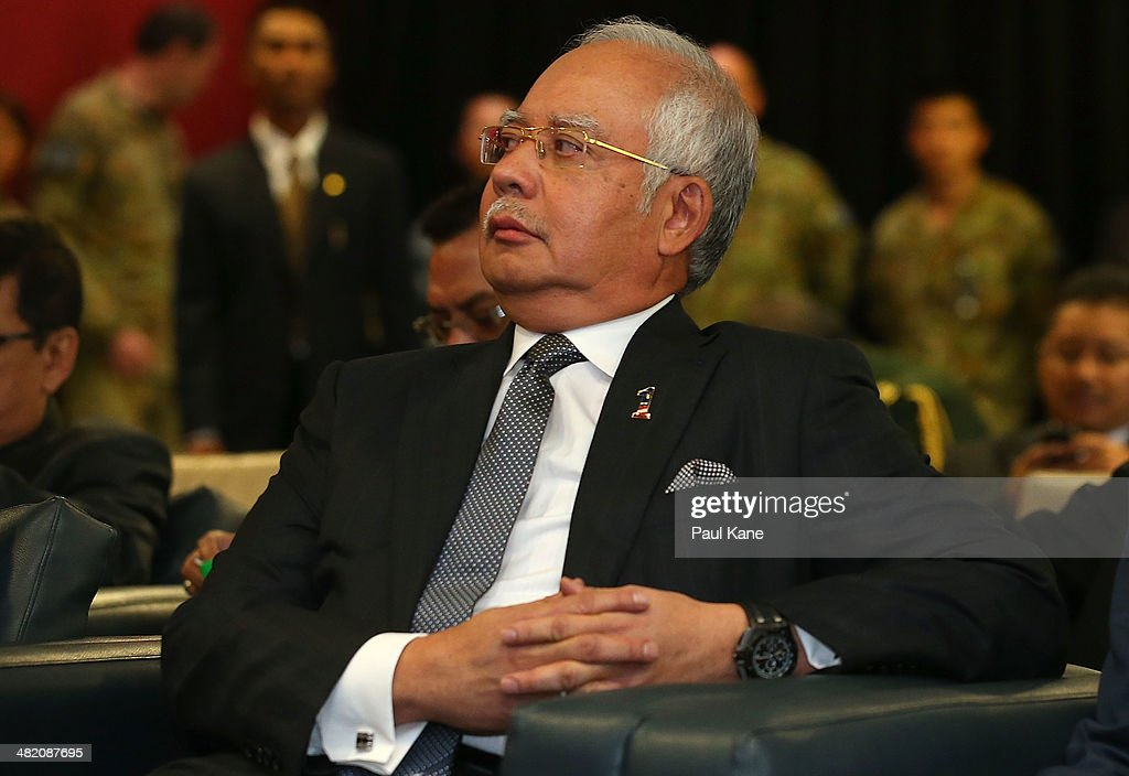 Malaysian Prime Minister Najib Razak looks on as Air Chief Marshall Angus Houston commence his briefing about the search mission for the missing Malaysia Airlines flight MH370 at RAAF base Pearce on April 3, 2014 in Perth, Australia. The search continues off the Western Australian coast for Malaysia Airlines flight MH370 that vanished on March 8 with 239 passengers and crew on board. The flight is suspected to have crashed into the southern Indian Ocean with no survivors.