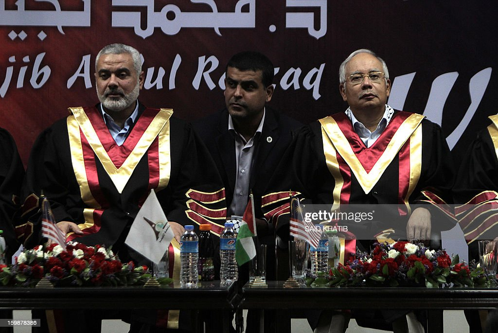 Malaysian Prime Minister Najib Razak (R) sits with Palestinian Hamas prime minister Ismail Haniya (L) during a visit to the Al-Aqsa University in Khan Yunis in the southern Gaza Strip January 22, 2013. Razak pledged solidarity with the Palestinians on his first trip to Gaza, and backed reconciliation efforts between Hamas and Fatah.