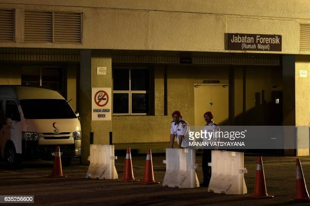 Malaysian private security guards stand guard outside the Forensics department at Putrajaya Hospital in Putrajaya on February 14 where the body of a...