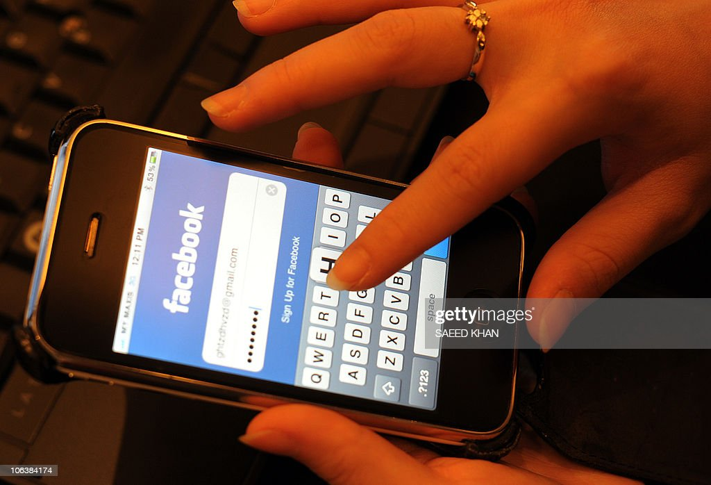 Malaysian professional writes her password to enter facebook for social networking in Kuala Lumpur on October 31, 2010. Malaysians are the most popular people on the Internet, while Japanese are the least, according to a global survey which shows how national cultures are reflected in online behaviour. Malaysians won the Internet popularity contest with an average of 233 friends in their social network, compared to 68 in China and just 29 in Japan, according to the Digital Life study by global research firm TNS. AFP PHOTO / Saeed Khan