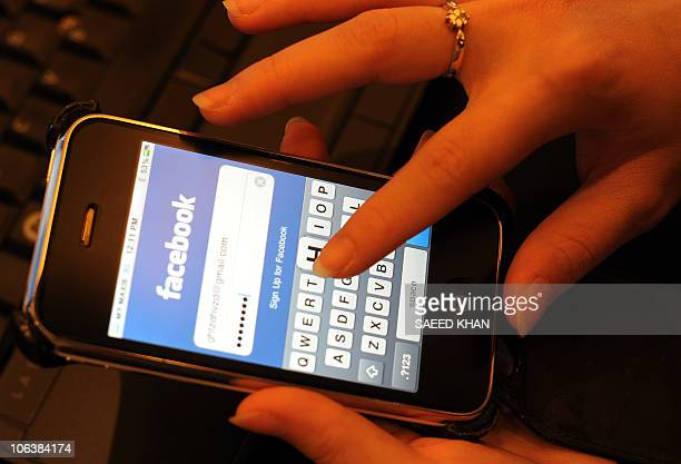 Malaysian professional writes her password to enter facebook for social networking in Kuala Lumpur on October 31 2010 Malaysians are the most popular...