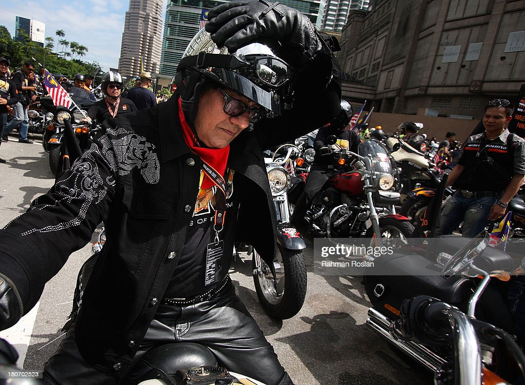 A Malaysian rider adjusts his helmet at the start of the bike parade in the heart of the city on September 16, 2013 in Kuala Lumpur, Malaysia. Malaysia hosts Asia Harley Days, a first of its kind event in Southeast Asia to engage with not only its consumers, but also with their fans in the region.