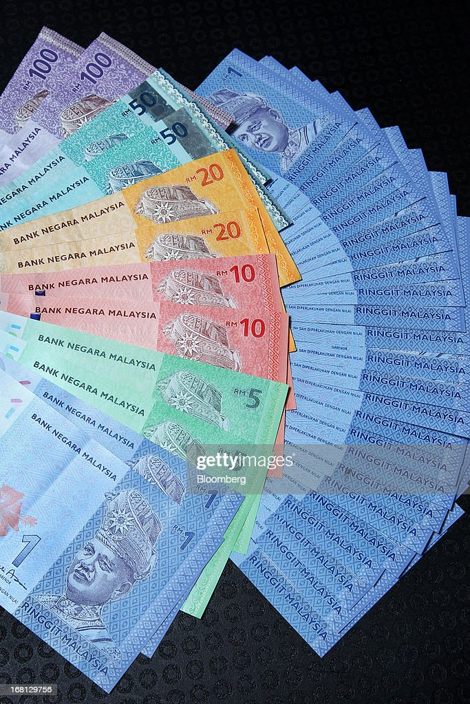 Malaysian ringgit banknotes of various denominations are arranged for a photograph in Kuala Lumpur, Malaysia, on Friday, May 3, 2013. Malaysia's stocks jumped the most since 2008 after Prime Minister Najib Razak won a clear majority in the election, giving him a mandate to continue his economic reforms. The ringgit gained the most in three years. Photographer: Goh Seng Chong/Bloomberg via Getty Images
