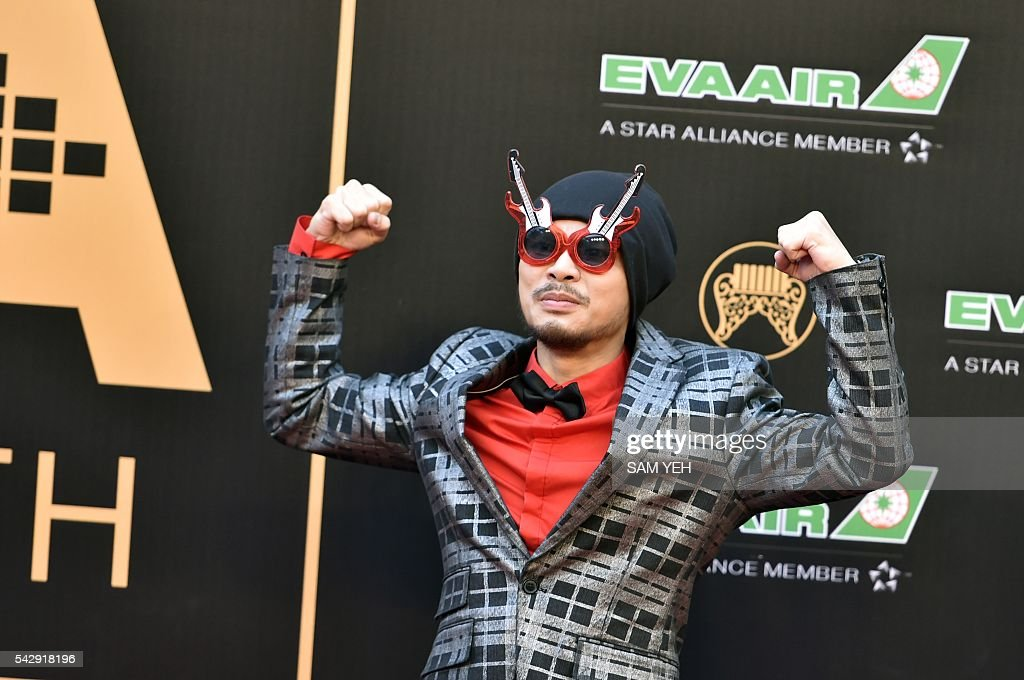 Malaysian singer Namewee arrives to attend the 27th Golden Melody Awards in Taipei on June 25, 2016. Some of Mandarin pop's biggest names have gathered for the annual Golden Melody music awards, with singers, songwriters and composers from Taiwan, China, Hong Kong, Singapore and Malaysia competing in more than 20 categories. / AFP / SAM YEH