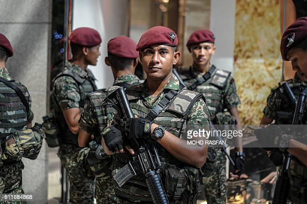 A Malaysian soldier from the 10th Paratrooper Brigade looks on before the arrival of Malaysian Prime Minister Najib Razak for a joint policearmy...