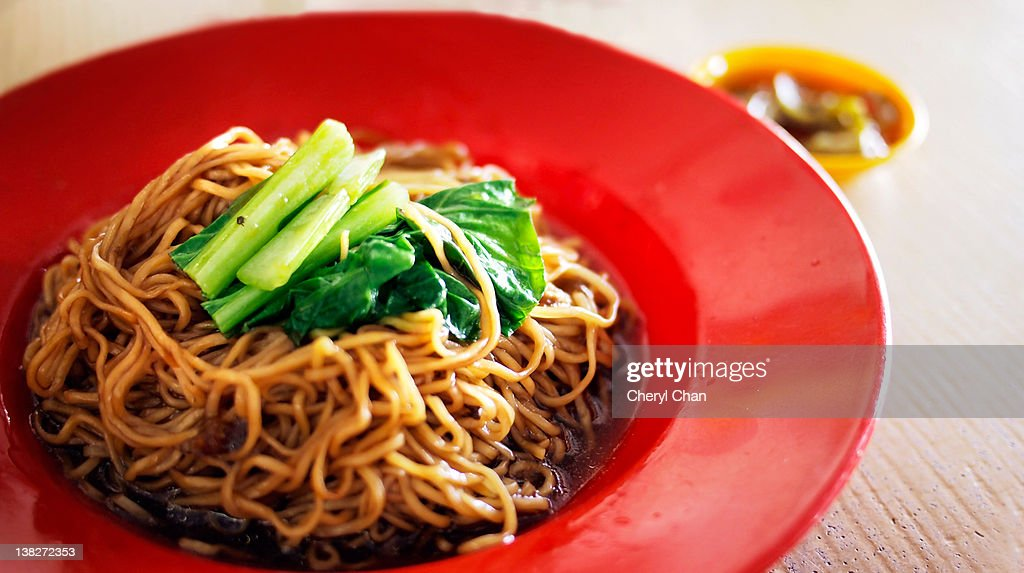 Malaysian style wanton noodle in red plate : Stock Photo