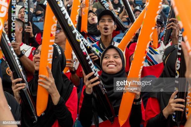 Malaysian supporter cheers during the Malaysia Thailand men's water polo round robin match at the South East Asian Games in Kuala Lumpur Malaysia won...