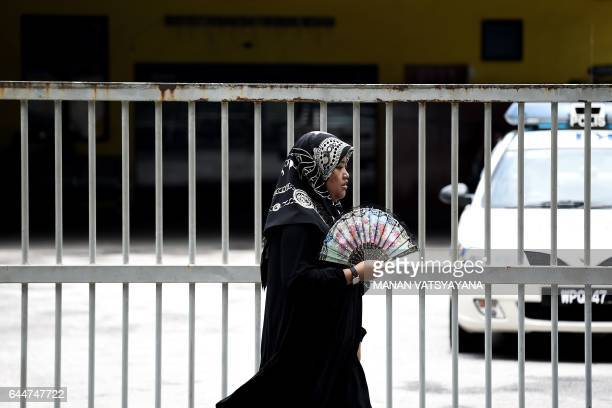 Malaysian woman walks past the forensics wing of the Hospital Kuala Lumpur in the Malaysian capital on February 24 where the body of Kim JongNam the...