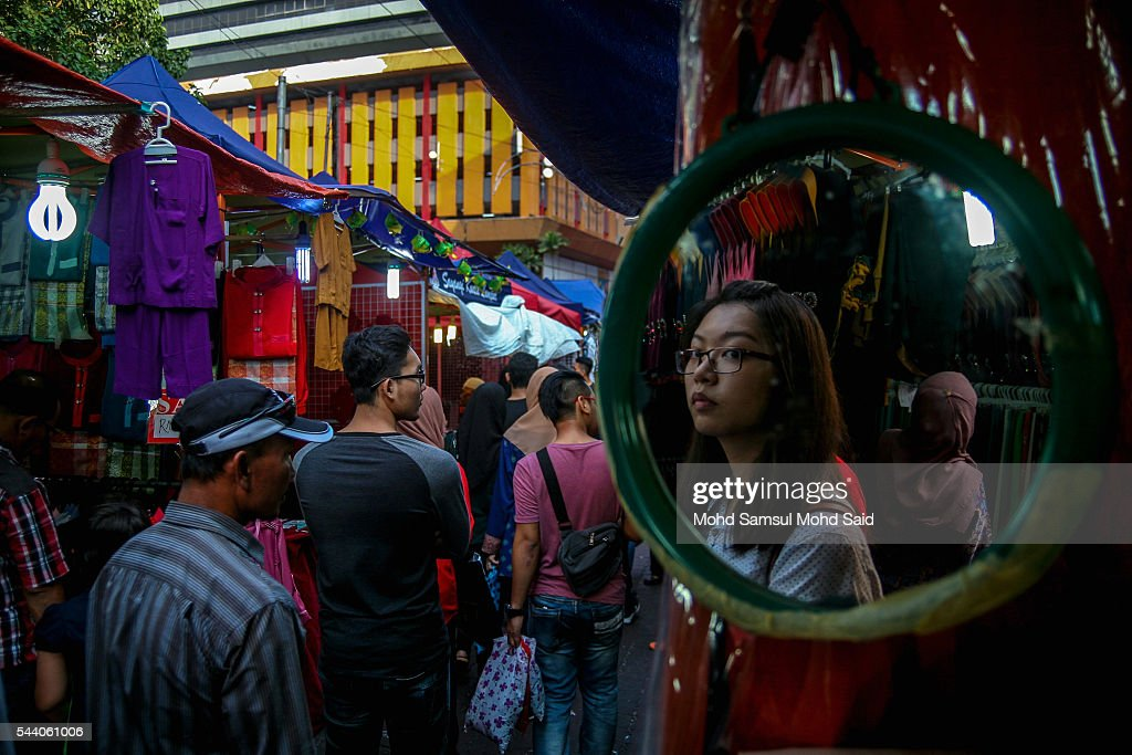 A Malaysian women is seen on mirror inside the Bazaar ramadan ahead of the Eid al-Fitri festival on July 1, 2016 in Kuala Lumpur, Malaysia. Southeast Asia's Muslims are observing the fasting month of Ramadan, Islam's holiest month, during which observant believers fast from dawn to dusk. Malaysia Muslims spend extra on food and new clothes for Eid al-Fitr, the most important festival in Islam, which marks the end of Ramadan spending seems to be holding up in Malaysia and in neighbouring Indonesia, which together account for about 14 percent of the world's Muslims.